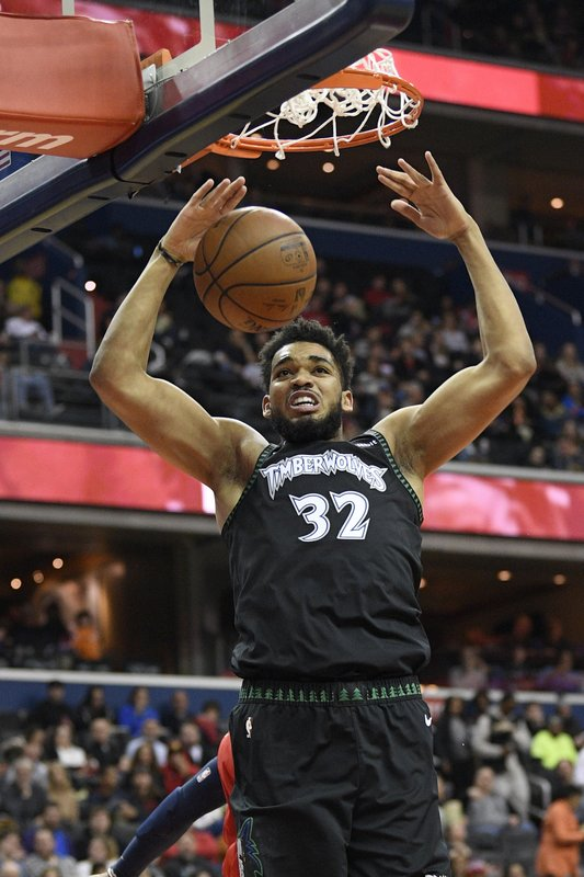 Minnesota Timberwolves center Karl-Anthony Towns (32) dunks during the first half of an NBA basketball game against the Washington Wizards, Sunday, March 3, 2019, in Washington. (AP Photo/Nick Wass)