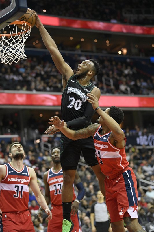 Minnesota Timberwolves guard Josh Okogie (20) goes to the basket against Washington Wizards guard Bradley Beal (3), guard Tomas Satoransky (31) and forward Jeff Green (32) during the first half of an NBA basketball game, Sunday, March 3, 2019, in Washington. (AP Photo/Nick Wass)