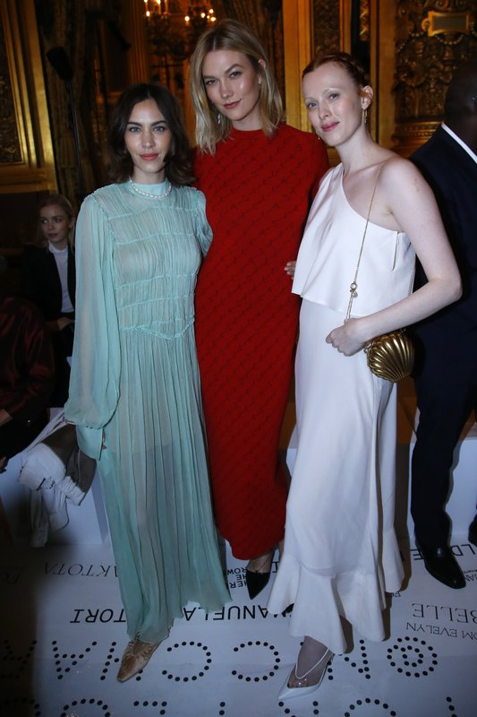 Model Karlie Kloos, center, Alexa Chung, left and Karen Elson pose before the presentation of Stella McCartney's ready-to-wear Fall-Winter 2019-2020 fashion collection, Monday March 4, 2019 in Paris. (AP Photo/Michel Euler)