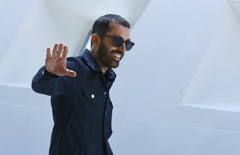 Italian designer Giambattista Valli accepts applause after his ready-to-wear Fall-Winter 2019-2020 fashion collection, that was presented in Paris, Monday, March 4, 2019. (AP Photo/Michel Euler)