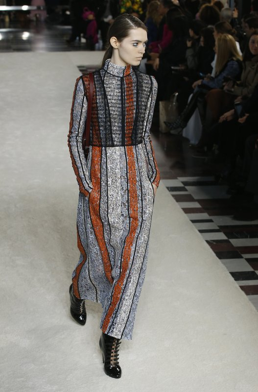 A model wears a creation as part of the Giambattista Valli ready-to-wear Fall-Winter 2019-2020 fashion collection, that was presented in Paris, Monday, March 4, 2019. (AP Photo/Michel Euler)