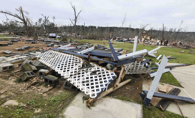 Debris litters the property of a destroyed home on Lee County Road 63 in Beauregard, Ala., Monday, March 4, 2019, the day after a deadly tornado ravaged the area. (AP Photo/Julie Bennett)