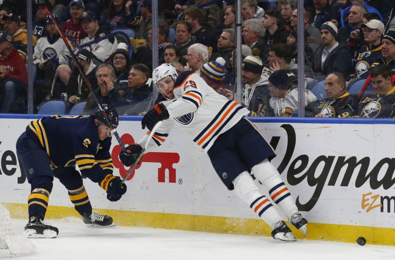 Buffalo Sabres forward Jack Eichel (9) and Edmonton Oilers forward Leon Draisaitl (29) collide during the second period of an NHL hockey game, Monday, March 4, 2019, in Buffalo N. (AP Photo/Jeffrey T. Barnes)