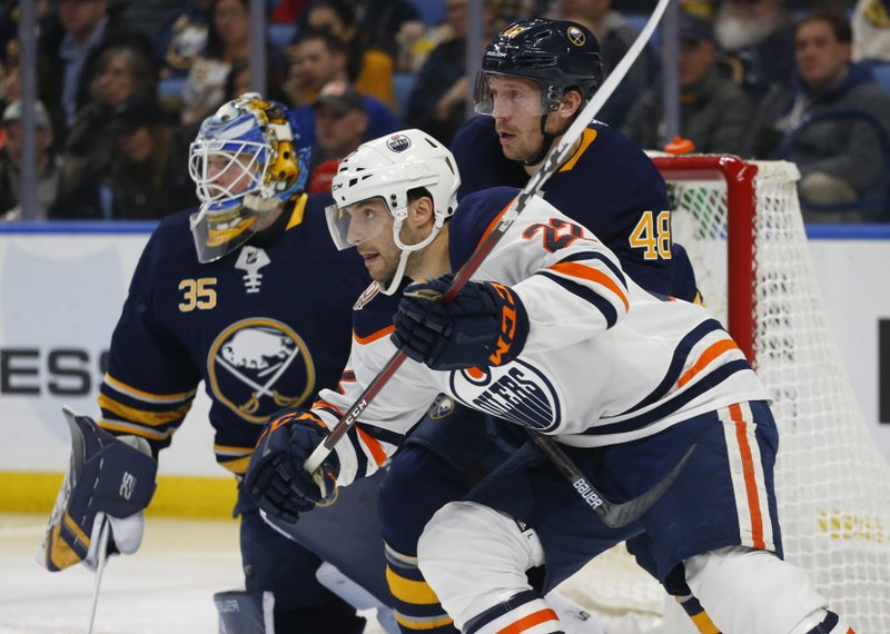 CORRECTS TO OILERS FORWARD TOBIAS RIEDER NOT OILERS FORWARD DARNELL NURSE - Buffalo Sabres defenseman Matt Hunwick (48) and Edmonton Oilers forward Tobias Rieder (22) battle for position during the second period of an NHL hockey game, Monday, March 4, 2019, in Buffalo N. (AP Photo/Jeffrey T. Barnes)