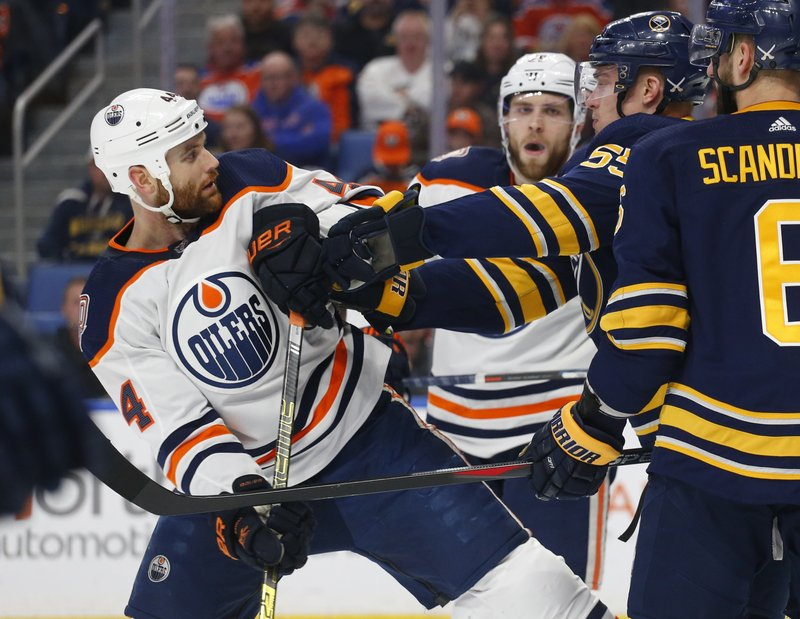 Buffalo Sabres defenseman Rasmus Ristolainen (55) pushes Edmonton Oilers forward Zack Kassian (44) during the first period of an NHL hockey game, Monday, March 4, 2019, in Buffalo N. (AP Photo/Jeffrey T. Barnes)