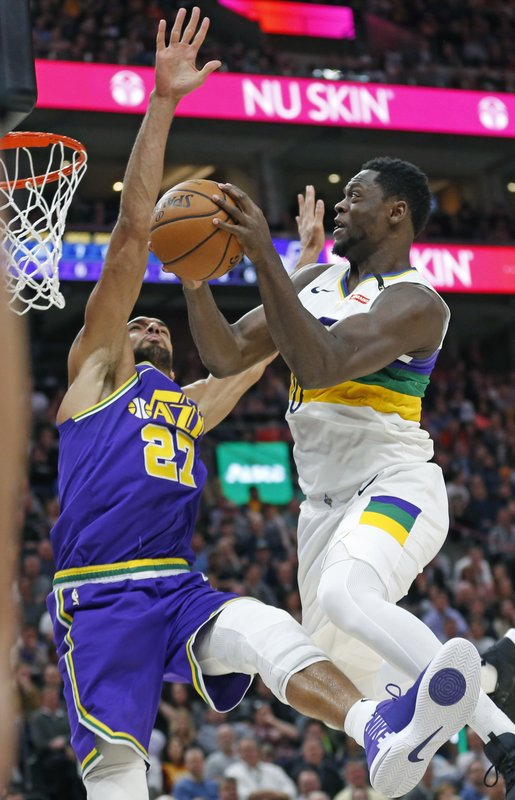 Utah Jazz center Rudy Gobert (27) defends against New Orleans Pelicans center Julius Randle, right, who goes to the basket in the first half during an NBA basketball game Monday, March 4, 2019, in Salt Lake City. (AP Photo/Rick Bowmer)
