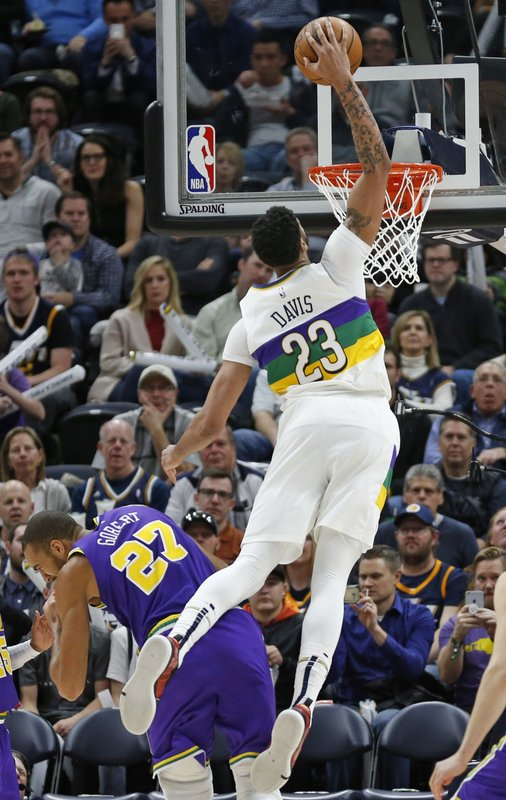New Orleans Pelicans forward Anthony Davis (23) dunks against Utah Jazz center Rudy Gobert (27) in the second half during an NBA basketball game Monday, March 4, 2019, in Salt Lake City. (AP Photo/Rick Bowmer)