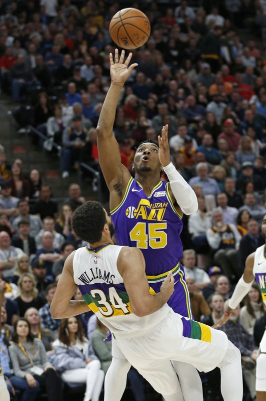 New Orleans Pelicans guard Kenrich Williams (34) takes a charge from Utah Jazz guard Donovan Mitchell (45) in the second half during an NBA basketball game Monday, March 4, 2019, in Salt Lake City. (AP Photo/Rick Bowmer)