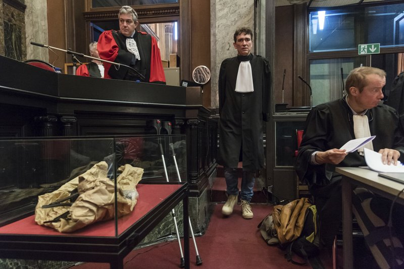 Lawyer for the accused, Sebastien Courtoy, center, attends the trial of Mehdi Nemmouche at the Justice Palace in Brussels, Thursday, Feb. (AP Photo/Geert Vanden Wijngaert, Pool)