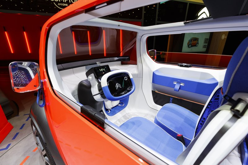 The Citroen Ami One Concept car is displayed during the press day at the '89th Geneva International Motor Show' in Geneva, Switzerland, Tuesday, March 5, 2019. (Cyril Zingaro/Keystone via AP)