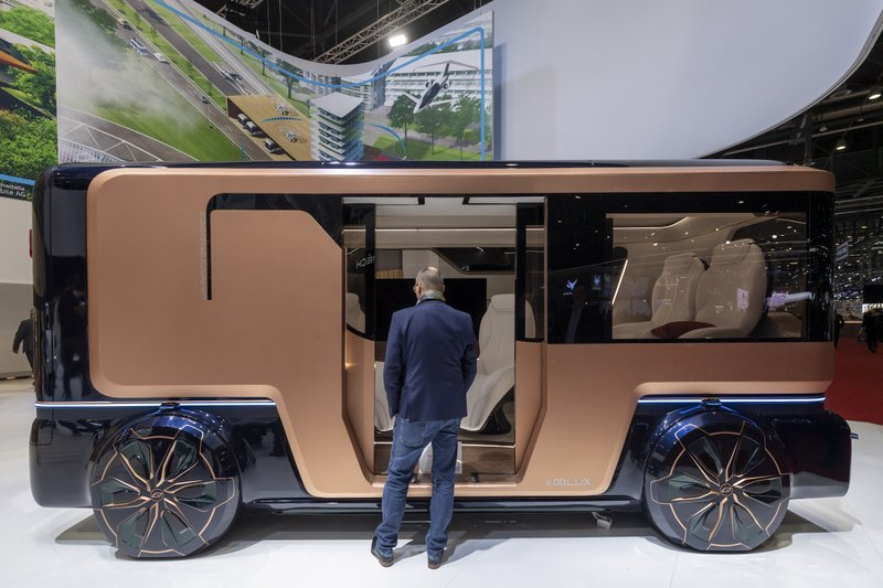 A person looks at the e.GO Lux during the press day at the '89th Geneva International Motor Show' in Geneva, Switzerland, Tuesday, March 5, 2019. (Martial Trezzini/Keystone via AP)