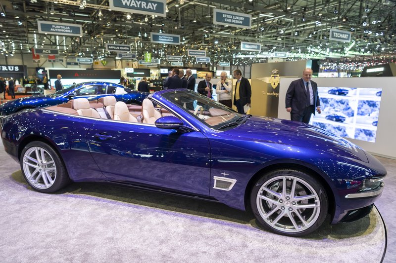 Visitors look at the new Touring Superleggera Sciadipersia cabriolet during the press day at the '89th Geneva International Motor Show' in Geneva, Switzerland, Tuesday, March 5, 2019. (Martial Trezzini/Keystone via AP)