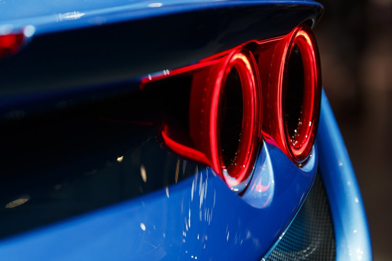 A rear light of the new Ferrari F8 Triturbo is pictured during the press day at the '89th Geneva International Motor Show' in Geneva, Switzerland, Tuesday, March 5, 2019. (Cyril Zingaro/Keystone via AP)
