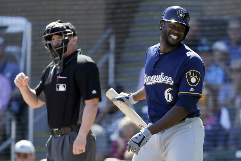 Milwaukee Brewers' Lorenzo Cain reacts after striking out against the Colorado Rockies during the first inning of a spring baseball game in Scottsdale, Ariz. (AP Photo/Chris Carlson)
