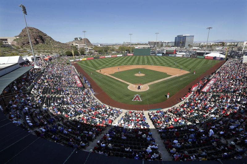 Fans fill most of the seats at Tempe Diablo Stadium, the Los Angeles Angels' spring stadium ballpark, during the team's spring training baseball game against the Chicago Cubs on Tuesday, March 5, 2019, in Tempe, Ariz. (AP Photo/Elaine Thompson)