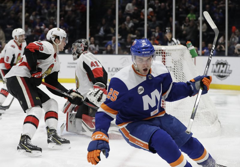New York Islanders defenseman Devon Toews (25) reacts after scoring a goal on Ottawa Senators goaltender Craig Anderson (41) during the second period of an NHL hockey game Tuesday, March 5, 2019, in Uniondale, N. (AP Photo/Kathy Willens)