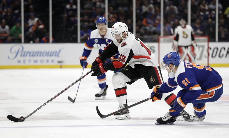 New York Islanders center Valtteri Filppula (51), of Finland, defends against Ottawa Senators left wing Zack Smith (15) during the first period of an NHL hockey game Tuesday, March 5, 2019, in Uniondale, N. (AP Photo/Kathy Willens)