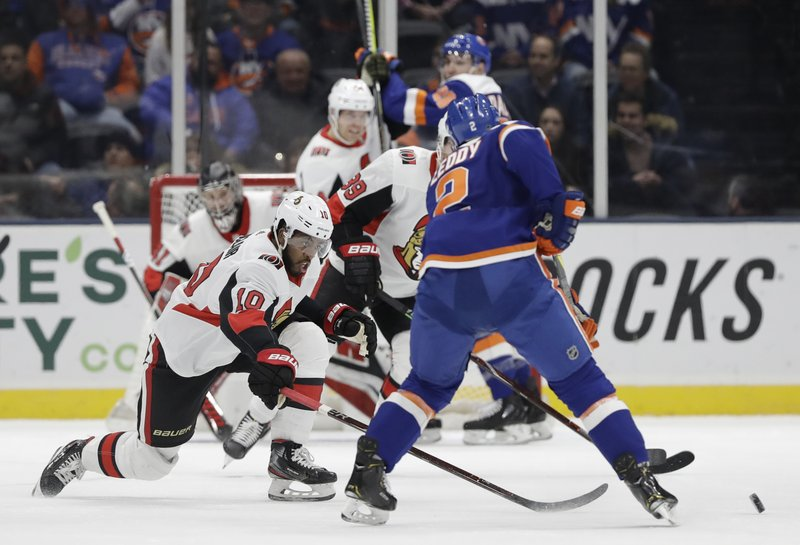 Ottawa Senators left wing Anthony Duclair (10) tries to block New York Islanders defenseman Nick Leddy (2), who looks for a shot on goal during the first period of an NHL hockey game Tuesday, March 5, 2019, in Uniondale, N. (AP Photo/Kathy Willens)