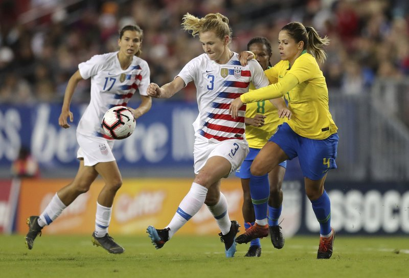 United States' Samantha Mewis drives past Brazil's Erika during the first half of a SheBelieves Cup soccer match Tuesday, March 5, 2019, in Tampa, Fla. (AP Photo/Mike Carlson)