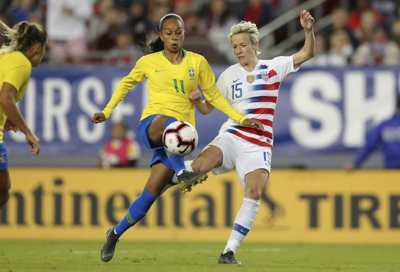 Brazil's Adriana and United States' Megan Rapinoe battle for a loose ball during the first half of a SheBelieves Cup soccer match Tuesday, March 5, 2019, in Tampa, Fla. (AP Photo/Mike Carlson)