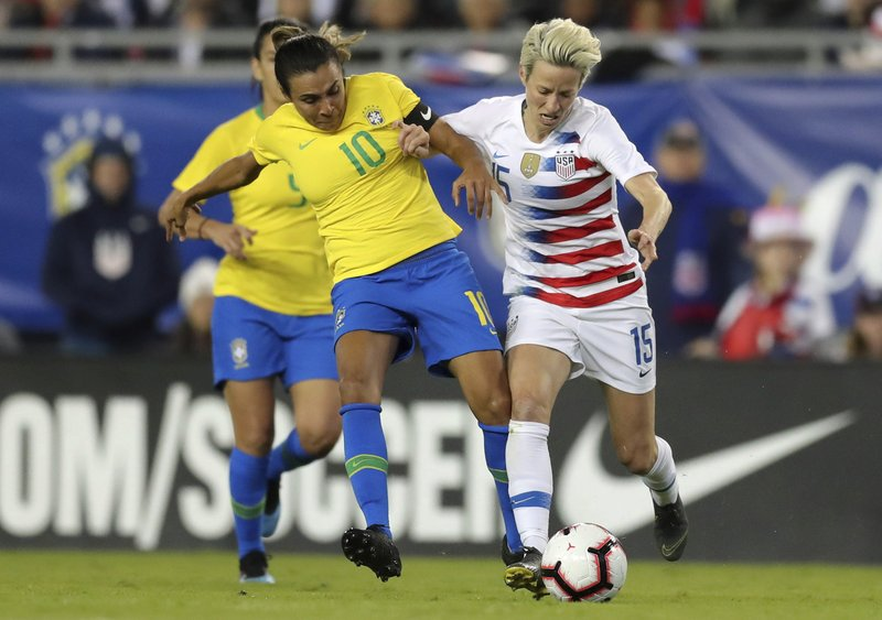 Brazil's Marta and United States' Megan Rapinoe compete for the ball during the first half of a SheBelieves Cup soccer match Tuesday, March 5, 2019, in Tampa, Fla. (AP Photo/Mike Carlson)