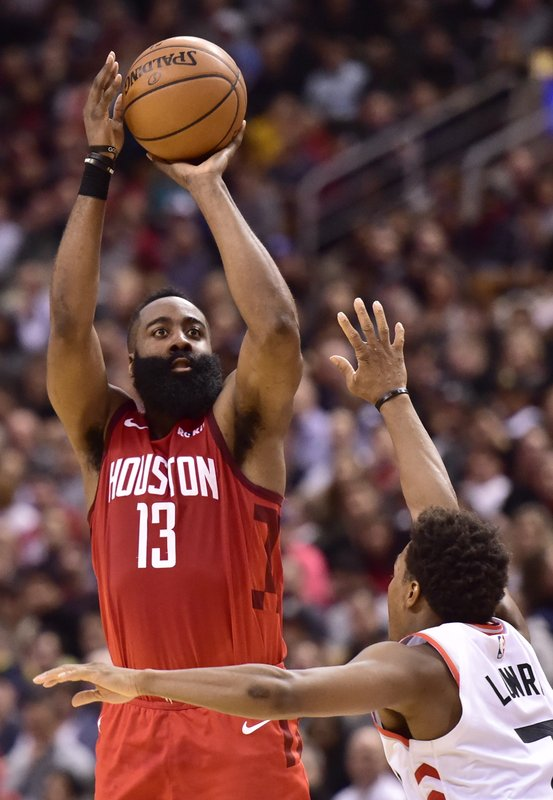 Houston Rockets guard James Harden (13) shoots over Toronto Raptors guard Kyle Lowry (7) during the second half of an NBA basketball game Tuesday, March 5, 2019, in Toronto. (Frank Gunn/The Canadian Press via AP)