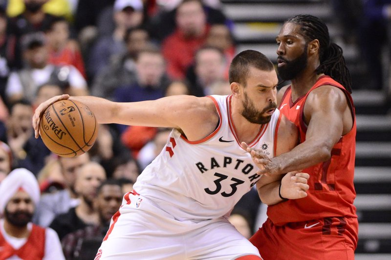 Toronto Raptors centre Marc Gasol (33) pushes against Houston Rockets centre Nene Hilario (42) during the second half of an NBA basketball game Tuesday, March 5, 2019, in Toronto. (Frank Gunn/The Canadian Press via AP)