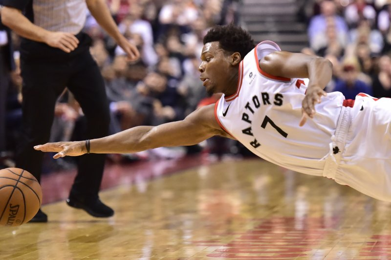Toronto Raptors guard Kyle Lowry (7) tries but can't keep the ball inbounds during the second half of the team's NBA basketball game against the Houston Rockets on Tuesday, March 5, 2019, in Toronto. (Frank Gunn/The Canadian Press via AP)