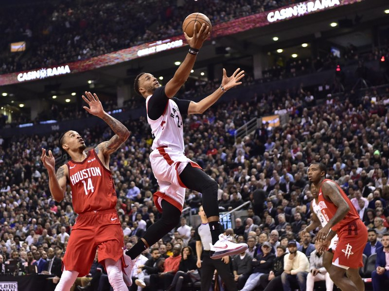 Toronto Raptors forward Norman Powell (24) jumps to the basket as Houston Rockets guard Gerald Green (14) watches during the first half of an NBA basketball game Tuesday, March 5, 2019, in Toronto. (Frank Gunn/The Canadian Press via AP)