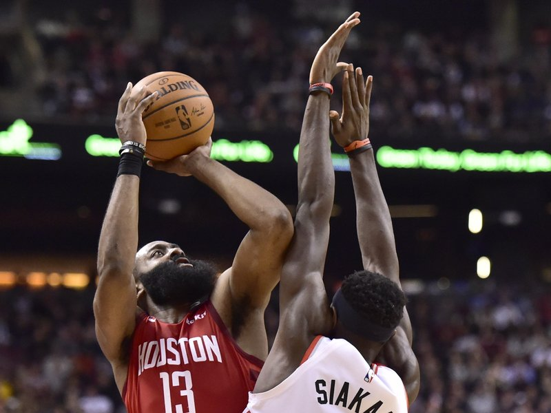 Houston Rockets guard James Harden (13) shoots over Toronto Raptors forward Pascal Siakam during the second half of an NBA basketball game Tuesday, March 5, 2019, in Toronto. (Frank Gunn/The Canadian Press via AP)