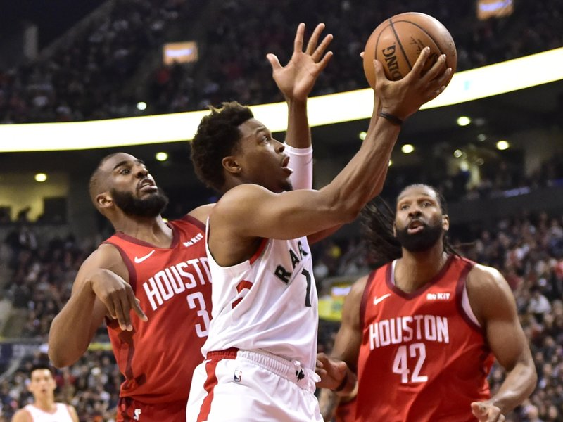 Toronto Raptors guard Kyle Lowry (7) heads for the basket as Houston Rockets guard Chris Paul (3) defends during the first half of an NBA basketball game Tuesday, March 5, 2019, in Toronto. (Frank Gunn/The Canadian Press via AP)