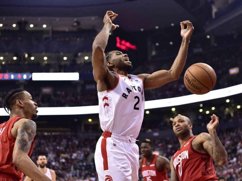 Toronto Raptors forward Kawhi Leonard (2) reacts after being fouled by Houston Rockets forward PJ Tucker (17) during the first half of an NBA basketball game Tuesday, March 5, 2019, in Toronto. (Frank Gunn/The Canadian Press via AP)