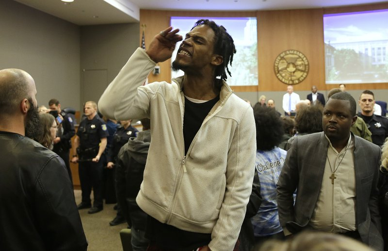 Protester Alexander Clark who is not related to Stephon Clark disrupts the Sacramento City Council during meeting Tuesday, March 5, 2019, in Sacramento, Calif. (AP Photo/Rich Pedroncelli)
