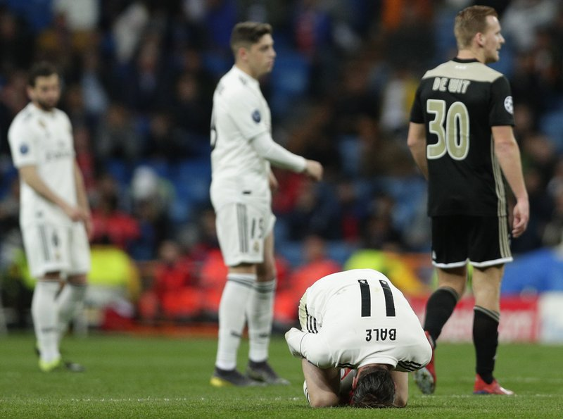 Real midfielder Gareth Bale reacts on the ground during the Champions League soccer match between Real Madrid and Ajax at the Santiago Bernabeu stadium in Madrid, Spain, Tuesday, March 5, 2019. (AP Photo/Manu Fernandez)