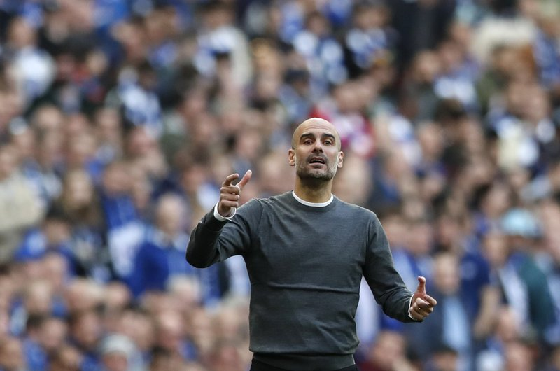 Manchester City manager Pep Guardiola gestures during the English League Cup final soccer match between Chelsea and Manchester City at Wembley stadium in London, England, Sunday, Feb. (AP Photo/Alastair Grant)