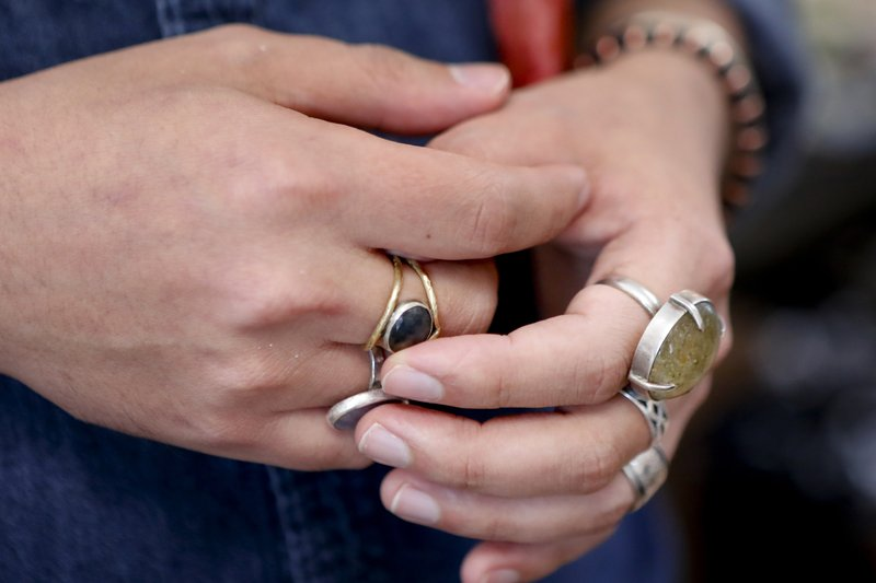 In this Thursday, Feb. 28, 2019, photo co-owner Andrew Thornton touches one of his rings as he talks about his jewelry and art store, Allegory Gallery, in the small town of Ligonier, Pa. (AP Photo/Keith Srakocic)