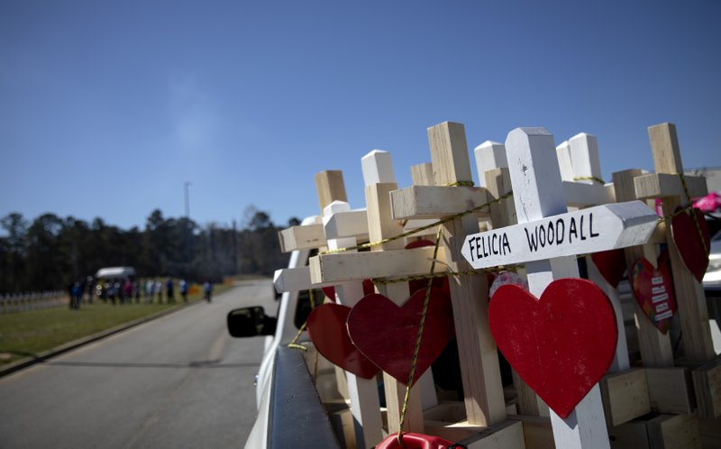 Crosses sit in the back of Greg Zanis' pickup truck as part of a makeshift memorial he made for the victims of a tornado in Opelika, Ala. (AP Photo/David Goldman)