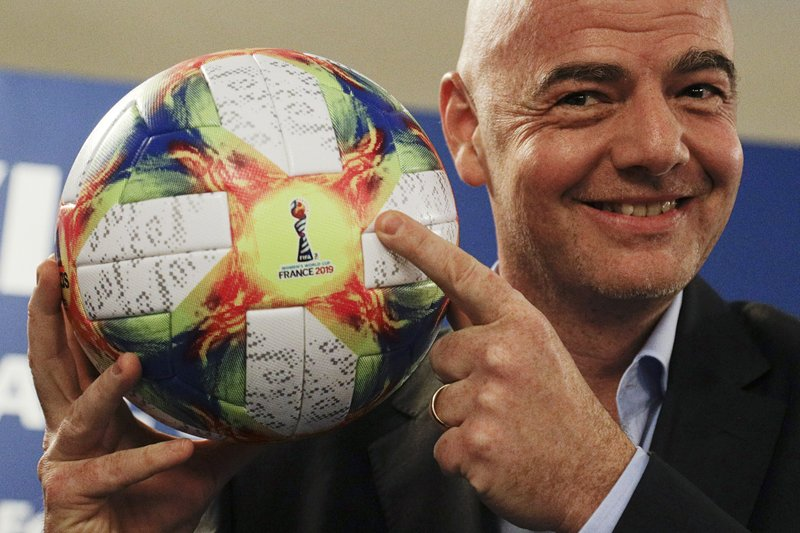 FILE - In this Feb. 27, 2019, file photo, FIFA President Gianni Infantino holds the official ball of the upcoming Women's Soccer World Championship as he poses for photographers during a press conference at the end of an executive committee meeting in Rome. (AP Photo/Gregorio Borgia, File)