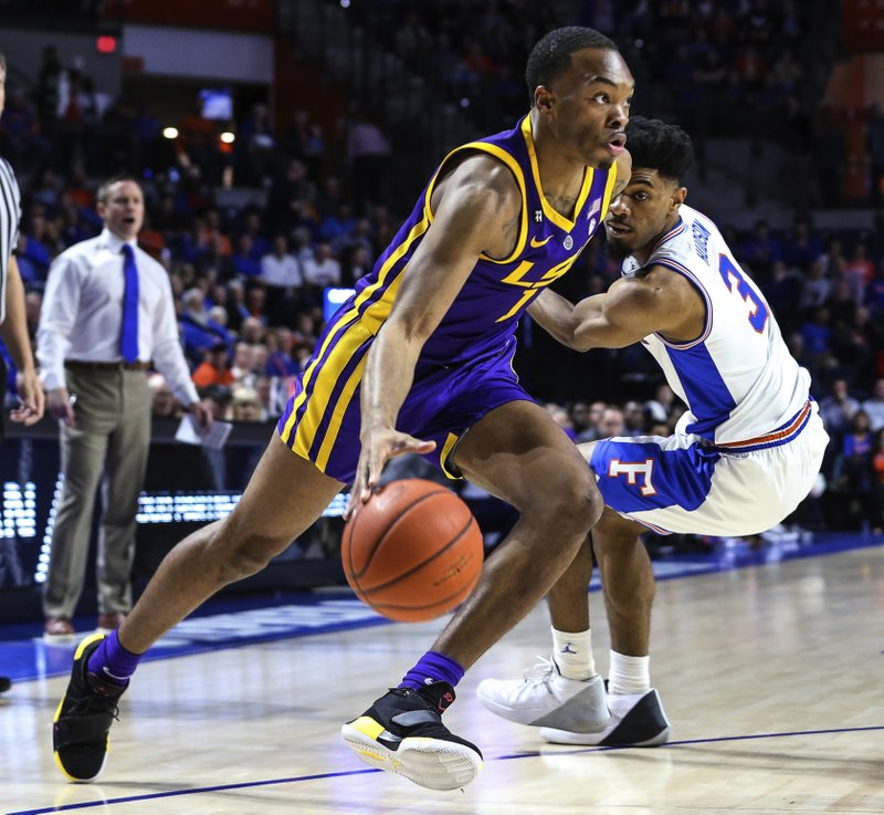 LSU guard Javonte Smart (1) drives to the basket while defended by Florida guard Jalen Hudson (3) during the first half of an NCAA college basketball game in Gainesville, Fla. (AP Photo/Gary McCullough)