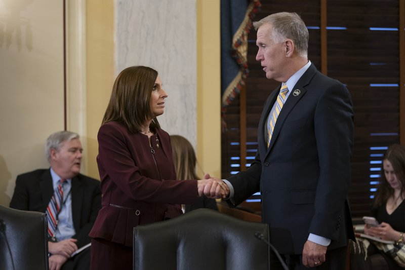 Sen. Martha McSally, R-Ariz., left, is greeted by Sen. Thom Tillis, R-N.C., chairman of the Senate Armed Services Subcommittee on Personnel, as she prepares to testify about her experience with sexual assault while serving as a colonel in the Air Force, on Capitol Hill in Washington, Wednesday, March 6, 2019. (AP Photo/J. Scott Applewhite)
