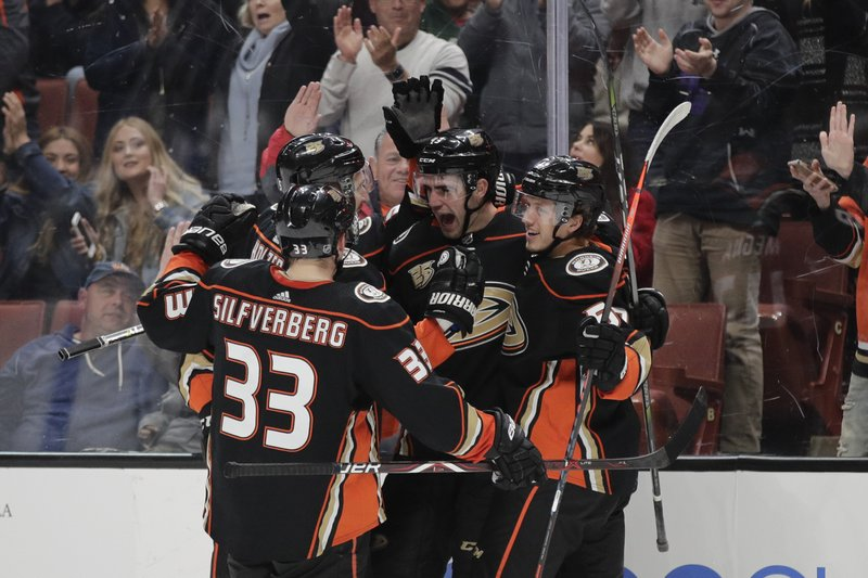 Anaheim Ducks' Jaycob Megna, second from right, celebrates his goal with Jakob Silfverberg, Korbinian Holzer and Rickard Rakell, from left, during the second period of an NHL hockey game against the St. (AP Photo/Jae C. Hong)