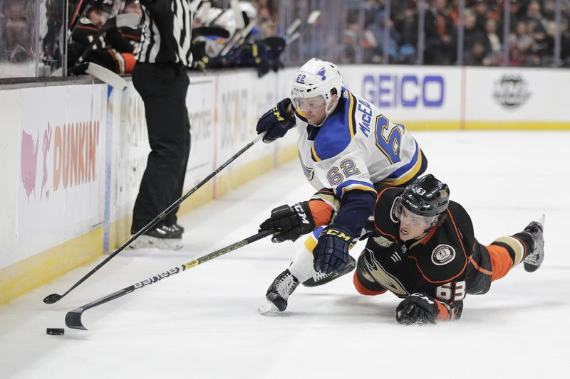 St. Louis Blues' Mackenzie MacEachern, top, and Anaheim Ducks' Kevin Roy fight for the puck during the second period of an NHL hockey game Wednesday, March 6, 2019, in Anaheim, Calif. (AP Photo/Jae C. Hong)
