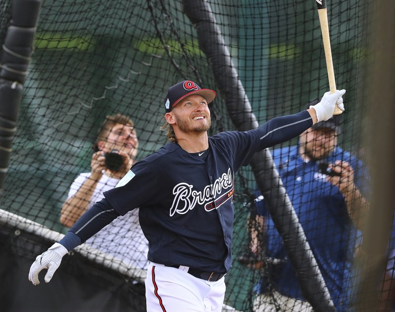 FILE - In this Thursday, Feb. 21, 2019 file photo, Atlanta Braves newly acquired third baseman Josh Donaldson smiles while watching the ball leave the park during batting practice at the team's spring training baseball facility in Kissimmee, Fla. (Curtis Compton/Atlanta Journal-Constitution via AP, File)