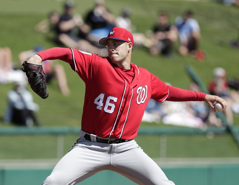 FILE - In this Monday, Feb. 25, 2019 file photo, Washington Nationals' Patrick Corbin (46) pitches in the first inning against the Atlanta Braves in a spring baseball exhibition game in Kissimmee, Fla. (AP Photo/John Raoux, File)
