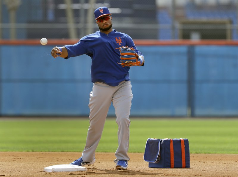FILE - In this Monday, Feb. 18, 2019 file photo, New York Mets infielder Robinson Cano throws to first during spring training baseball practice in Port St. (AP Photo/Jeff Roberson, File)