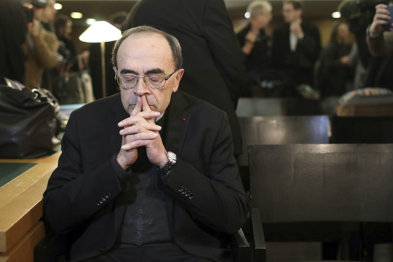 FILE - In this Jan. 7, 2019 file photo, French Cardinal Philippe Barbarin waits for the start of his trial at the Lyon courthouse, central France. (AP Photo/Laurent Cipriani, File)