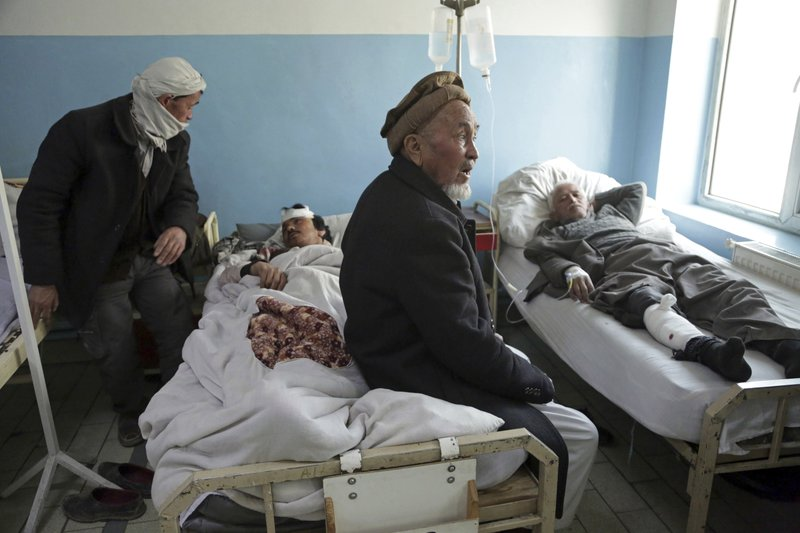 Wounded men lie on beds at a hospital in Kabul, Afghanistan, Thursday, March 7, 2019. Afghan officials say several explosions have struck outside a ceremony in Kabul attended by the country's chief executive and the former president, both of whom were unharmed. (AP Photo/Rahmat Gul)