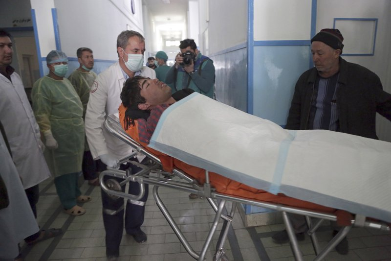 Afghans move a man injured in an explosion, at a hospital in Kabul, Afghanistan, Thursday, March 7, 2019. (AP Photo/Rahmat Gul)