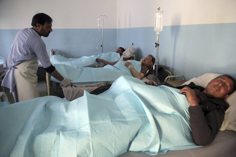 Men wounded by an explosion lie on beds at a hospital in Kabul, Afghanistan, Thursday, March 7, 2019. (AP Photo/Rahmat Gul)