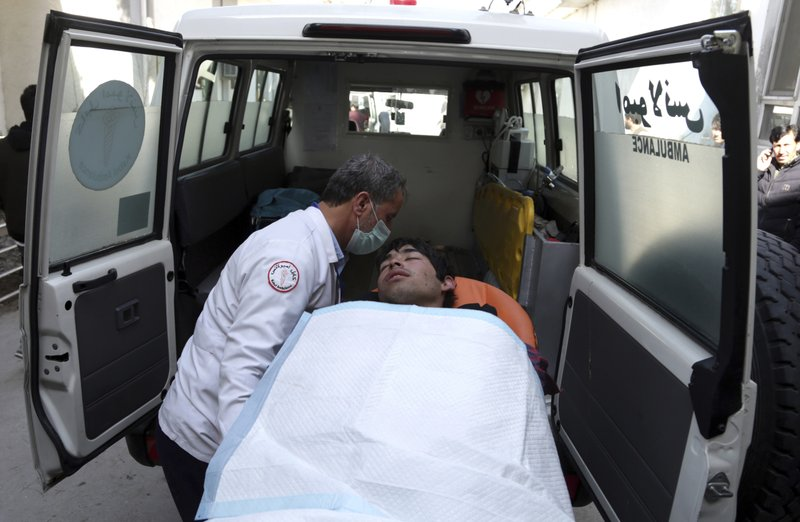 An injured man is put into an ambulance at a hospital in Kabul, Afghanistan, Thursday, March 7, 2019. (AP Photo/Rahmat Gul)
